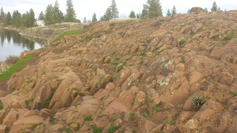 Top of cliffs with lots of fractures and red soil