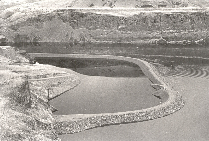 The Marmes Rockshelter and attempted structures to save it are flooded in February 1969